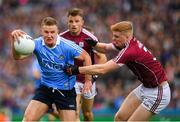 11 August 2018; Ciarán Kilkenny of Dublin is tackled by Seán Andy Ó Ceallaigh of Galway during the GAA Football All-Ireland Senior Championship semi-final match between Dublin and Galway at Croke Park in Dublin.  Photo by Ray McManus/Sportsfile