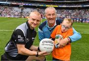 11 August 2018; GAA legend and former Dublin goalkeeper John O'Leary who walked onto the pitch with his son Tom, age 7, who presented the ball to the referee, Barry Cassidy, on behalf of the Jack & Jill Children's Foundation at Croke Park in Dublin. Tom, who has a very rare condition, has been supported by Jack & Jill home nursing care and John is a board member and ambassador for the charity. Photo by Ray McManus/Sportsfile