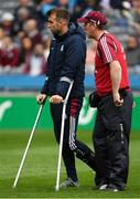 11 August 2018; Injured Galway player Paul Conroy with team doctor, Dr Enda Devitt, before the GAA Football All-Ireland Senior Championship semi-final match between Dublin and Galway at Croke Park in Dublin.  Photo by Piaras Ó Mídheach/Sportsfile