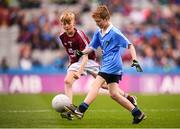 11 August 2018; Turlough Muldoon, Roan St Patrick's PS Eglish, Tyrone, representing Dublin, and Jeffrey Oates, St. Michael's & St. Patrick's NS, Boyle, Roscommon, representing Galway, during the INTO Cumann na mBunscol GAA Respect Exhibition Go Games at the GAA Football All-Ireland Senior Championship Semi Final match between Dublin and Galway at Croke Park in Dublin. Photo by Stephen McCarthy/Sportsfile