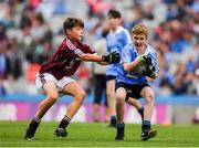 11 August 2018; Turlough Muldoon, Roan St Patrick's PS Eglish, Tyrone, representing Dublin, in action against Dylan Coady, St Mary's NS, Ballygunner, Waterford, representing Galway, during the INTO Cumann na mBunscol GAA Respect Exhibition Go Games at the GAA Football All-Ireland Senior Championship Semi Final match between Dublin and Galway at Croke Park in Dublin.  Photo by Brendan Moran/Sportsfile