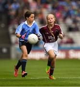 11 August 2018; Saoirse Martin, St Mary's PS, Newtownbutler, Fermanagh, representing Dublin, in action against Gracie Crimmins, St Brigid's PS Drumilly, Down, representing Galway,  during the INTO Cumann na mBunscol GAA Respect Exhibition Go Games at the GAA Football All-Ireland Senior Championship Semi Final match between Dublin and Galway at Croke Park in Dublin. Photo by Ray McManus/Sportsfile