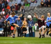 11 August 2018; Mattie McDermott, St Paul's PS, Irvinestown, Fermanagh, representing Dublin, in action against Jeffrey Oates, St. Michael's & St. Patrick's NS, Boyle, Roscommon, representing Galway, during the INTO Cumann na mBunscol GAA Respect Exhibition Go Games at the GAA Football All-Ireland Senior Championship Semi Final match between Dublin and Galway at Croke Park in Dublin. Photo by Ray McManus/Sportsfile