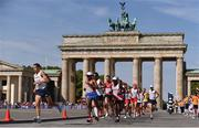 12 August 2018; The leading group passes the Brandenburg Gate whilst competing in the Men's Marathon event during Day 6 of the 2018 European Athletics Championships in Berlin, Germany. Photo by Sam Barnes/Sportsfile