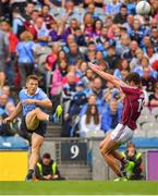 11 August 2018; Paul Flynn of Dublin kicks a point despite the best efforts of Micheal Daly of Galway during the GAA Football All-Ireland Senior Championship semi-final match between Dublin and Galway at Croke Park in Dublin.  Photo by Brendan Moran/Sportsfile