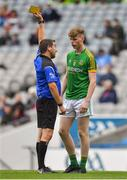 11 August 2018; Matthew Costello of Meath is shown a yellow card by referee Noel Mooney during the Electric Ireland GAA Football All-Ireland Minor Championship semi-final match between Galway and Meath at Croke Park in Dublin. Photo by Brendan Moran/Sportsfile