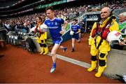 12 August 2018; Karl O'Connell of Monaghan makes his way onto the pitch past RNLI members prior to the GAA Football All-Ireland Senior Championship semi-final match between Monaghan and Tyrone at Croke Park in Dublin. Photo by Stephen McCarthy/Sportsfile