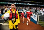12 August 2018; Tiernan McCann and Ronan O'Neill of Tyrone make their way onto the pitch past RNLI volunteers prior to the GAA Football All-Ireland Senior Championship semi-final match between Monaghan and Tyrone at Croke Park in Dublin. Photo by Stephen McCarthy/Sportsfile