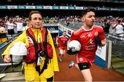 12 August 2018; Mattie Donnelly of Tyrone leads his side onto the pitch past RNLI volunteers prior to the GAA Football All-Ireland Senior Championship semi-final match between Monaghan and Tyrone at Croke Park in Dublin. Photo by Stephen McCarthy/Sportsfile