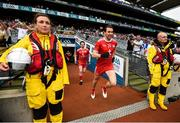 12 August 2018; Conall McCann of Tyrone makes his way onto the pitch past RNLI volunteers prior to the GAA Football All-Ireland Senior Championship semi-final match between Monaghan and Tyrone at Croke Park in Dublin. Photo by Stephen McCarthy/Sportsfile