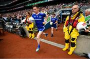 12 August 2018; Karl O'Connell of Monaghan makes his way onto the pitch past RNLI volunteers prior to the GAA Football All-Ireland Senior Championship semi-final match between Monaghan and Tyrone at Croke Park in Dublin. Photo by Stephen McCarthy/Sportsfile