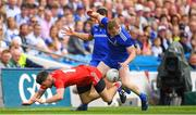 12 August 2018; Mattie Donnelly of Tyrone is tackled by Colin Walshe of Monaghan during the GAA Football All-Ireland Senior Championship semi-final match between Monaghan and Tyrone at Croke Park in Dublin. Photo by Ramsey Cardy/Sportsfile