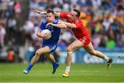 12 August 2018; Karl O'Connell of Monaghan is tackled by Colm Cavanagh of Tyrone during the GAA Football All-Ireland Senior Championship semi-final match between Monaghan and Tyrone at Croke Park in Dublin. Photo by Ramsey Cardy/Sportsfile
