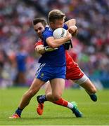 12 August 2018; Conor McCarthy of Monaghan is tackled by the Tyrone full back Ronan McNamee during the GAA Football All-Ireland Senior Championship semi-final match between Monaghan and Tyrone at Croke Park in Dublin. Photo by Ray McManus/Sportsfile