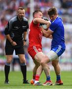 12 August 2018; Darren Hughes of Monaghan is tackled by Kieran McGeary of Tyrone during the GAA Football All-Ireland Senior Championship semi-final match between Monaghan and Tyrone at Croke Park in Dublin. Photo by Ramsey Cardy/Sportsfile