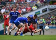 12 August 2018; Connor McAliskey of Tyrone is tackled by Drew Wylie and Karl O'Connell of Monaghan during the GAA Football All-Ireland Senior Championship semi-final match between Monaghan and Tyrone at Croke Park in Dublin. Photo by Ray McManus/Sportsfile