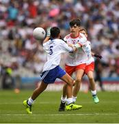 12 August 2018; Peter Ballesty, Milltown NS, Mullingar, Co Westmeath, representing Tyrone, in action against Cian Denis, St Patrick's NS Drumshanbo, Leitrim, representing Monaghan,  during the INTO Cumann na mBunscol GAA Respect Exhibition Go Games at the GAA Football All-Ireland Senior Championship Semi Final match between Monaghan and Tyrone at Croke Park in Dublin. Photo by Ray McManus/Sportsfile