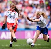 12 August 2018; Grace Morris, St Brigid's NS, Duagh NS, Listowel, Co Kerry, representing Tyrone, and Ciara O'Neill, The Rock NS, Portlaoise, Co Laois, representing Monaghan, during the INTO Cumann na mBunscol GAA Respect Exhibition Go Games at the GAA Football All-Ireland Senior Championship Semi Final match between Monaghan and Tyrone at Croke Park in Dublin.  Photo by Stephen McCarthy/Sportsfile