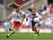 12 August 2018; Mia Shannon, St Teresa's NS, Co Longford, representing Tyrone, in action against Siomha McNulty, Gaelscoil de Búrca, Claremorris, Co Mayo, representing Monaghan, during the INTO Cumann na mBunscol GAA Respect Exhibition Go Games at the GAA Football All-Ireland Senior Championship Semi Final match between Monaghan and Tyrone at Croke Park in Dublin.  Photo by Brendan Moran/Sportsfile