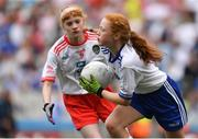12 August 2018; Julie Lennon, Gowran NS, Gowran, Co Kilkenny, representing Monaghan, in action against Sinéad McKeon, St Teresa's NS, Ballinalee, Co Longford, representing Tyrone, during the INTO Cumann na mBunscol GAA Respect Exhibition Go Games at the GAA Football All-Ireland Senior Championship Semi Final match between Monaghan and Tyrone at Croke Park in Dublin.  Photo by Brendan Moran/Sportsfile