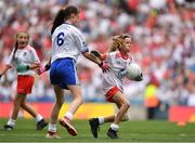 12 August 2018; Mia Shannon, St Teresa's NS, Co Longford, representing Tyrone, in action against Emma Griffin, Glinsk NS, Co Galway, representing Monaghan, during the INTO Cumann na mBunscol GAA Respect Exhibition Go Games at the GAA Football All-Ireland Senior Championship Semi Final match between Monaghan and Tyrone at Croke Park in Dublin.  Photo by Brendan Moran/Sportsfile
