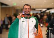 13 August 2018; Thomas Barr with his bronze medal at the Homecoming of the Irish Team from the European Athletics Championships in Berlin at Terminal 1 in Dublin Airport. Photo by Eóin Noonan/Sportsfile