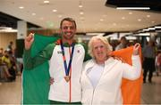 13 August 2018; Thomas Barr with Athletics Ireland President Georgina Drumm at the Homecoming of the Irish Team from the European Athletics Championships in Berlin at Terminal 1 in Dublin Airport. Photo by Eóin Noonan/Sportsfile