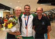 13 August 2018; Thomas Barr with his coaches Hayley and Drew Harrison at the Homecoming of the Irish Team from the European Athletics Championships in Berlin at Terminal 1 in Dublin Airport. Photo by Eóin Noonan/Sportsfile