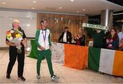 13 August 2018; Thomas Barr makes his way into the arrivals hall with his coach Hayley Harrison at the Homecoming of the Irish Team from the European Athletics Championships in Berlin at Terminal 1 in Dublin Airport. Photo by Eóin Noonan/Sportsfile