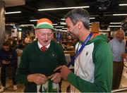 13 August 2018; Thomas Barr shows his medal to Irish athletics supporter Harry Gorman at the Homecoming of the Irish Team from the European Athletics Championships in Berlin at Terminal 1 in Dublin Airport. Photo by Eóin Noonan/Sportsfile