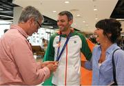 13 August 2018; Thomas Barr shows his bronze medal to his father Tommy and his mother Martina at the Homecoming of the Irish Team from the European Athletics Championships in Berlin at Terminal 1 in Dublin Airport. Photo by Eóin Noonan/Sportsfile