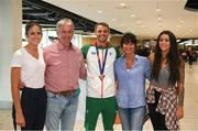 13 August 2018; Thomas Barr, centre, with his family, from left, Jessie, Tommy, Martina and Becky at the Homecoming of the Irish Team from the European Athletics Championships in Berlin at Terminal 1 in Dublin Airport. Photo by Eóin Noonan/Sportsfile