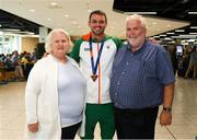 13 August 2018; Thomas Barr with Athletics Ireland president Georgina Drumm and vice president John Cronin at the Homecoming of the Irish Team from the European Athletics Championships in Berlin at Terminal 1 in Dublin Airport. Photo by Eóin Noonan/Sportsfile