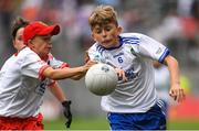 12 August 2018; Lorcan Buckley, Ballapousta NS, Ardee, Co Louth, representing Monaghan, in action against Luca Ó hAodha, Gaelscoil Lios na nÓg, Raghnallach, Co Dublin, representing Tyrone, during the INTO Cumann na mBunscol GAA Respect Exhibition Go Games at the GAA Football All-Ireland Senior Championship Semi Final match between Monaghan and Tyrone at Croke Park in Dublin.  Photo by Piaras Ó Mídheach/Sportsfile