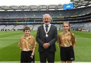 12 August 2018; Joe Killeen, President of the INTO, with Referee Francis Flynn, St Mary's NS Aughnasheelin, Co. Leitrim, and Referee Ellen Keany, St Brigid's NS, Drumcong, Co. Leitrim, before the INTO Cumann na mBunscol GAA Respect Exhibition Go Games at the GAA Football All-Ireland Senior Championship Semi Final match between Monaghan and Tyrone at Croke Park in Dublin.  Photo by Piaras Ó Mídheach/Sportsfile