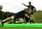 13 August 2018; Keynan Knox is tackled by Darren O'Shea during Munster Rugby squad training at the University of Limerick in Limerick. Photo by Diarmuid Greene/Sportsfile