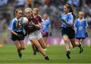 11 August 2018; Emer McEntee, Gowna NS, Gowna, Cavan, representing Galway, in action against Lea Carey, St. Mary's NS, Sandyford, Dublin, left, and Ruby O'Connell Bell, Our Lady of Good Counsel GNS, Dublin, during the INTO Cumann na mBunscol GAA Respect Exhibition Go Games at the GAA Football All-Ireland Senior Championship Semi Final match between Dublin and Galway at Croke Park in Dublin.  Photo by Piaras Ó Mídheach/Sportsfile
