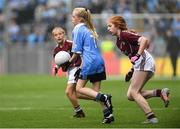 11 August 2018; Lucy Donoghue, Tobar an Léinn, Mountrath, Laois, representing Dublin, in action against Nicole McDaid, Scoil Iosagáin, Buncrana, Donegal, representing Galway,and Emily Breen, Roxborough NS, Ballysheedy, Limerick, representing Galway, behind, during the INTO Cumann na mBunscol GAA Respect Exhibition Go Games at the GAA Football All-Ireland Senior Championship Semi Final match between Dublin and Galway at Croke Park in Dublin.  Photo by Piaras Ó Mídheach/Sportsfile
