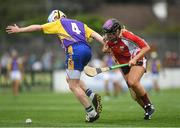 14 August 2018; Anna Geary, former Cork camogie player, representing Davy Russell's Best, fouls Ollie Canning, former Galway hurler, representing Jim Bolger's Stars, during the seventh annual Hurling for Cancer Research game, a celebrity hurling match in aid of the Irish Cancer Society at St Conleth's Park, in Newbridge. The event, organised by legendary racehorse trainer Jim Bolger and National Hunt jockey Davy Russell, has raised €700,000 to date to fund the Irish Cancer Society's innovative cancer research projects. Photo by Piaras Ó Mídheach/Sportsfile