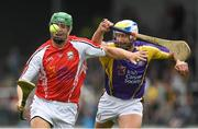 14 August 2018; Matthew O'Hanlon, Wexford hurler, representing Davy Russell's Best, left, in action against Jackie Tyrrell, former Kilkenny hurler, representing Jim Bolger's Stars, during the seventh annual Hurling for Cancer Research game, a celebrity hurling match in aid of the Irish Cancer Society at St Conleth's Park, in Newbridge. The event, organised by legendary racehorse trainer Jim Bolger and National Hunt jockey Davy Russell, has raised €700,000 to date to fund the Irish Cancer Society's innovative cancer research projects. Photo by Piaras Ó Mídheach/Sportsfile