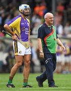 14 August 2018; Jackie Tyrrell, former Kilkenny hurler, representing Jim Bolger's Stars, with RTÉ pundit and former Galway hurling manager Cyril Farrell, acting as referee, during the seventh annual Hurling for Cancer Research game, a celebrity hurling match in aid of the Irish Cancer Society at St Conleth's Park, in Newbridge. The event, organised by legendary racehorse trainer Jim Bolger and National Hunt jockey Davy Russell, has raised €700,000 to date to fund the Irish Cancer Society's innovative cancer research projects. Photo by Piaras Ó Mídheach/Sportsfile