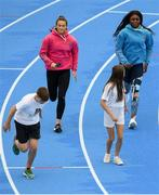 15 August 2018; Ireland's World Championships Relay Heroes Ciara Neville, Gina Akpe Moses and Patience Jumbo Gula at the launch Aldi Community Games' National Festival. Pictured at the launch is Ciara Neville and Patience Jumbo Gula with Josh Bowland, age 12, from Crecora Co. Limerick, and Emma Moroney, age 14, from Shanagolden Co. Limerick, at the new state of the art athletics track in UL, Limerick. Photo by Eóin Noonan/Sportsfile