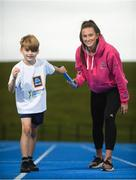 15 August 2018; Ireland's World Championships Relay Heroes Ciara Neville, Gina Akpe Moses and Patience Jumbo Gula at the launch Aldi Community Games' National Festival. Pictured at the launch is Ciara Neville with Elliot O'Connoll, age 7, from Raheen Co. Limerick at the new state of the art athletics track in UL, Limerick. Photo by Eóin Noonan/Sportsfile