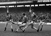 2 September 1973; Mick Crotty of Kilkenny, with team mate Jim Lynch, extreme right, has his shot blocked by Éamonn Cregan and Pat Hartigan of Limerick during the All Ireland Hurling Final match between Kilkenny and Limerick at Croke Park in Dublin. Photo by Connolly Collection/Sportsfile