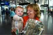 17 August 2018; Angela McKeon, with her grandaughter Stella Woods, age 10 months, from Longford, with the Liam MacCarthy Cup at the GAA Fáilte Abhaile event at Dublin Airport in Dublin. Photo by Piaras Ó Mídheach/Sportsfile