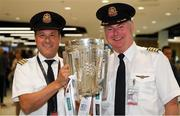17 August 2018; First Officer Patrick Galliker, left, and Captain Don O'Sullivan, of Air Canada, with the Liam MacCarthy Cup at the GAA Fáilte Abhaile event at Dublin Airport in Dublin. Photo by Piaras Ó Mídheach/Sportsfile