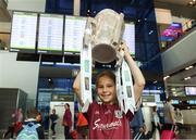 17 August 2018; Emma O'Connor, age 10, from Loughrea, Co Galway, with the Liam MacCarthy Cup at the GAA Fáilte Abhaile event at Dublin Airport in Dublin. Photo by Piaras Ó Mídheach/Sportsfile