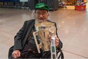 17 August 2018; John Hunt, age 98, originally from Athea, Co Limerick, and now living in Chicago, and home for the match, with the Liam MacCarthy Cup at the GAA Fáilte Abhaile event at Dublin Airport in Dublin. Photo by Piaras Ó Mídheach/Sportsfile