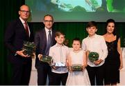 17 August 2018; The family of the late Liam Miller, wife Clare, sons Kory and Leo and daughter Belle, are presented with his Republic of Ireland international caps by An Tánaiste Simon Coveney TD and Republic of Ireland manager Martin O'Neill at the FAI Delegates Dinner & FAI Communications Awards at the Rochestown Park Hotel in Cork. Photo by Stephen McCarthy/Sportsfile