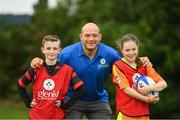 18 August 2018; Irish Rugby Captain and Glenisk ambassador Rory Best is pictured at an exclusive Glenisk Rugby Training Camp in De La Salle RFC with 100 lucky competition winners aged between 7 and 12 years. The camp, hosted by Glenisk, Official Yoghurt of Irish Rugby, was designed to encourage children to make new friends, develop their rugby skills and learn about the best foods for their growing bodies with advice from IRFU Performance Nutritionist Marcus Shortall. Pictured at the event is Rory Best, with Daithi Concannon, age 10, from Tourloughmore, Galway and Emily Daly, age 10, from Blessington, Wicklow during the camp at De La Salle Palmerstown RFC, Dublin. Photo by Eóin Noonan/Sportsfile